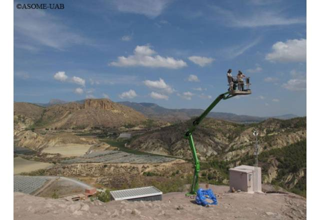 Archaeologists taking pictures of the archaeological site of La Bastida on a crane.